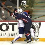Slovenia's Anze Kopitar (L) gets checked by Keith Ballard of the United States during the preliminary round of the 2008 IIHF World Hockey Championships at the Halifax Metro Centre in Halifax on Scotia May 4, 2008. AFP PHOTO/Timothy A. CLARY (Photo credit should read TIMOTHY A. CLARY/AFP/Getty Images)